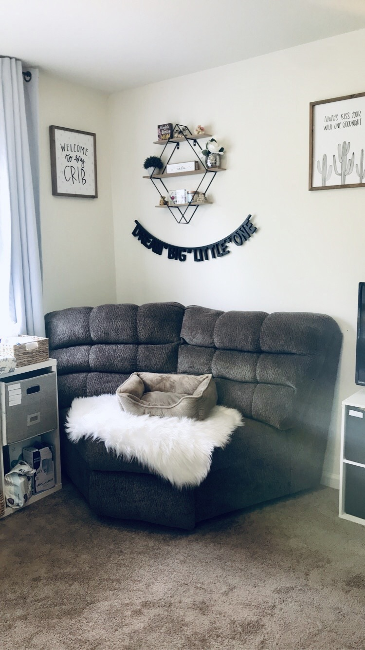 Corner seating, white fur rug, cat bed, wall hangings. Welcome to my crib picture. Diamond shaped wall hanging decor. BOY NURSERY TOUR 2020