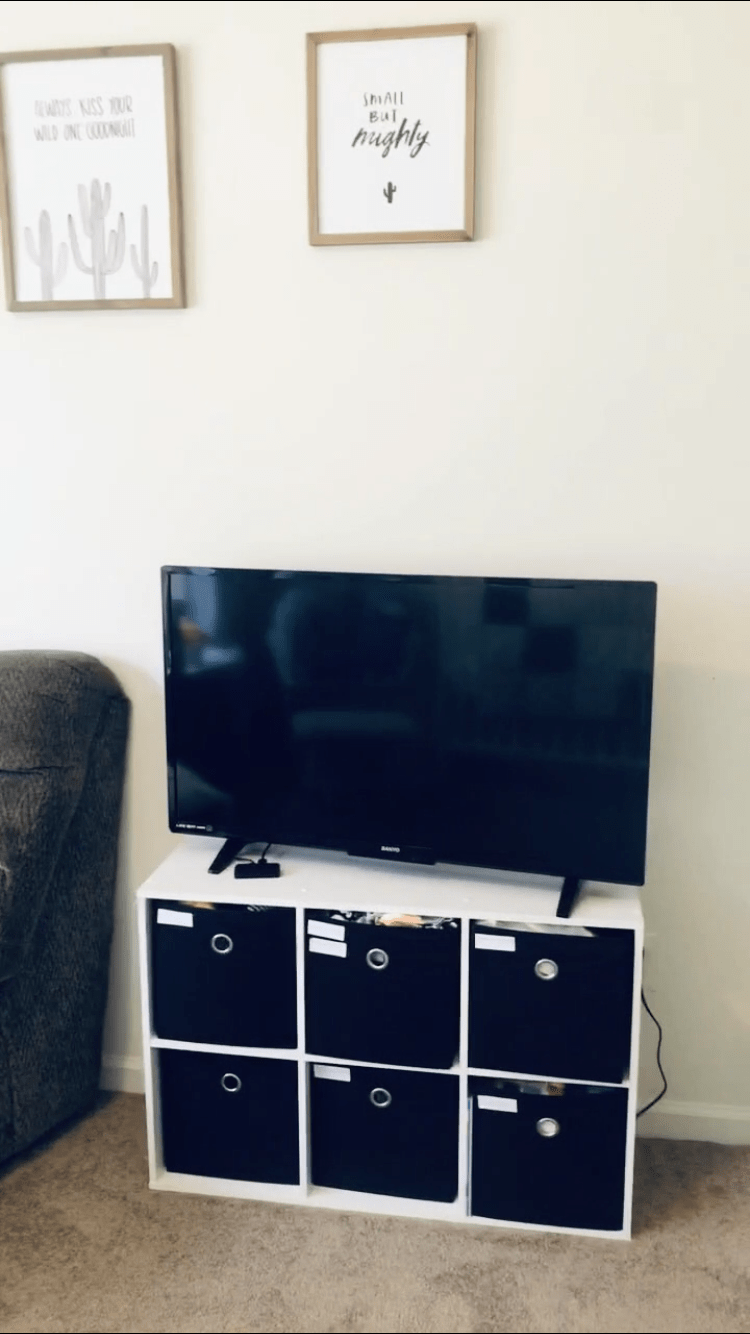 TV on 6 cube dresser. Small but mighty wall picture.