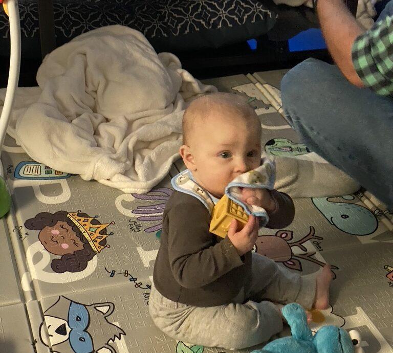 sebastian eating his bib.